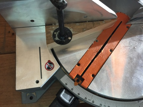 "The ""jig"" attached to the miter saw"